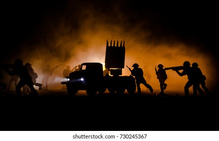 Rocket launch with fire clouds. Battle scene with rocket Missiles with Warhead Aimed at Gloomy Sky at night. Soldiers and Rockets War Backgound. Selective focus