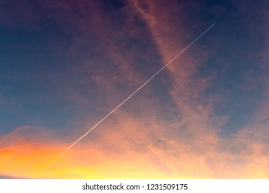 Rocket launch of a satellite at sunrise with visible contrail