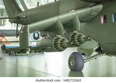 Rocket launcher below wing in helicopter