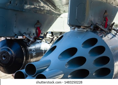 Rocket pod with empty rocket launcher under the wingtip of a helicopter. Uncontrolled aircraft missiles block. Launch missile device for unguided aircraft missiles. Weapons of mass destruction.