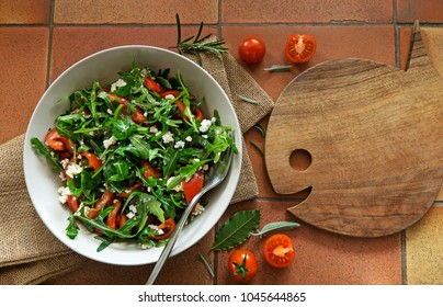 Rocket Salad with arugola tomato and cheese on background.