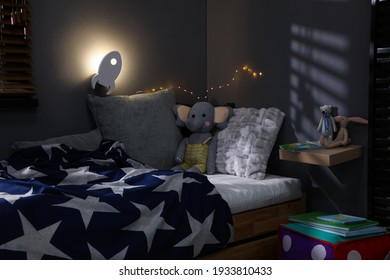 Rocket shaped night lamp on wall in child's room - Shutterstock ID 1933810433