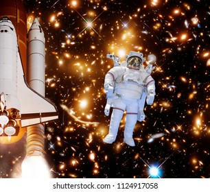Rocket (shuttle), astronaut in outer space and galaxy. The elements of this image furnished by NASA.