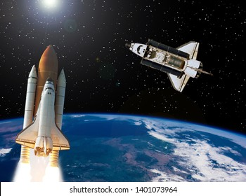 Rocket and shuttle flying in outer space. Space mission. The elements of this image furnished by NASA.