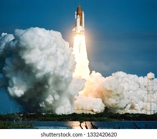 Rocket takes off into the sky. Lots of smoke and gas. The elements of this image furnished by NASA.