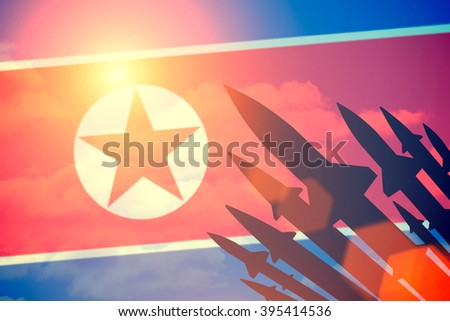 Rockets silhouettes background North Korea flag. Toned