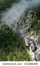 Rockface with fog at the Königssee