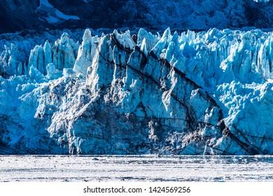 Rockface/rock face of Johns Hopkins Glacier & floating ice, Glacier Bay National Park and Preserve Alaska, a 12 mile long glacier in the tidewater inlet basin. Close up details captured October 2017.