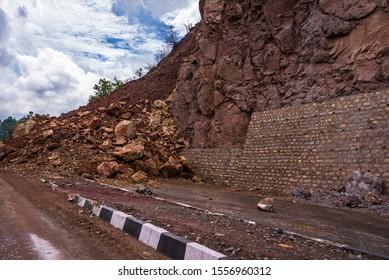 Rockfall blocked & causes traffic jam on Kalka Shimla expressway road during landslide after heavy rain due instable mountain slope by road widening blasting & deforestation.