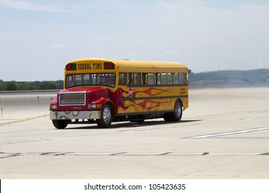ROCKFORD, IL - JUNE 3: A school bus with a jet engine in a race with an airplane at the annual Rockford Airfest on June 3, 2012 in Rockford, IL