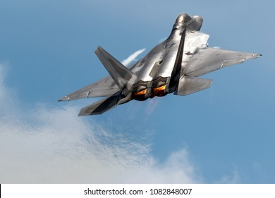 ROCKFORD, ILLINOIS / USA - June 6, 2015: A Lockheed Martin F-22 Raptor performs a demo at the 2015 Rockford Airfest.