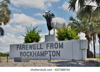 Rockhampton, Queensland, Australia - December 28, 2017. Statue of Brahman bull, at the Yeppen roundabout at Fairy Bower, with Farewell from Rockhampton sign.
