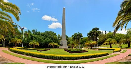 Rockhampton, Queensland, Australia - December 28, 2017. Lawn with memorial column at Botanic Gardens in Rockhampton, QLD, with vegetation.