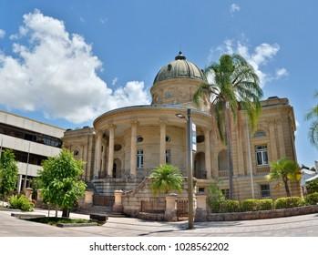 Rockhampton, Queensland, Australia - December 28, 2017. Historic building on Quay Street in Rockhampton, QLD, with surrounding buildings and vegetation.