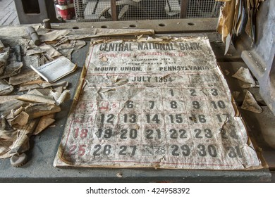 Rockhill, PA, USA - May 21, 2016 :  Relics from 1950's including bank calendar old railroad workroom