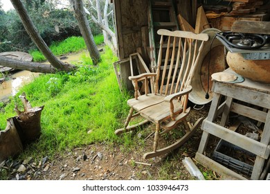 Rocking chair, gas stove, iron basin and other old things