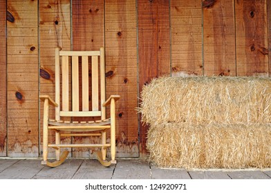 Rocking chair and hay stack on the front porch at the farm.