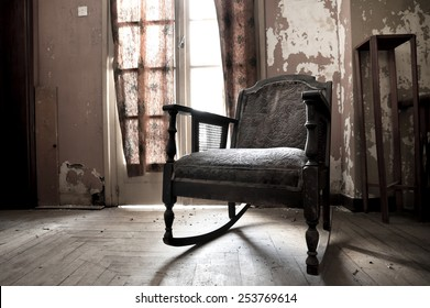 Rocking chair in an old dirty room