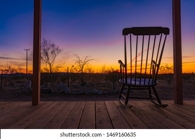 Rocking chair on the front porch during a sunset