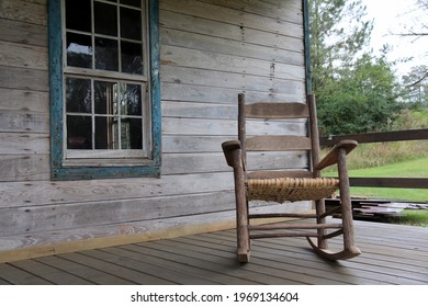 Rocking chair on the porch of an abandoned home in rural Alabama