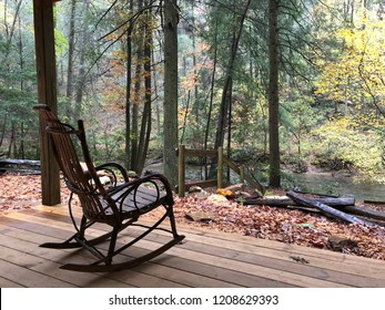 Rocking chair on porch next to river