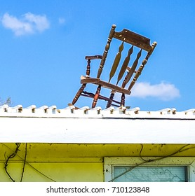 Rocking chair on the top of the roof of a house caused by the destruction of powerful Hurricane Harvey on the Texas Coast
