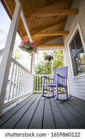 A rocking chair sitting on the cabin porch.