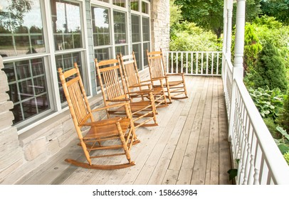 Rocking chairs invite one to relax on an old wooden front porch