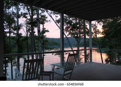 Rocking Chairs on the patio by the lake at sunset
