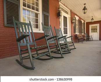 Rocking chairs on porch of historic New England house in Vermont