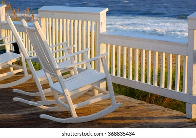 Rocking chairs on a porch over looking the beach