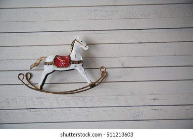 rocking horse on a wooden background for christmas