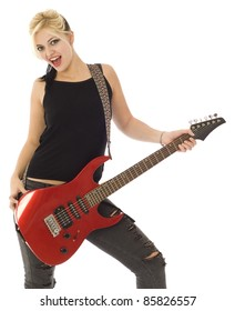 Rocking woman with red guitar looking at you isolated on white