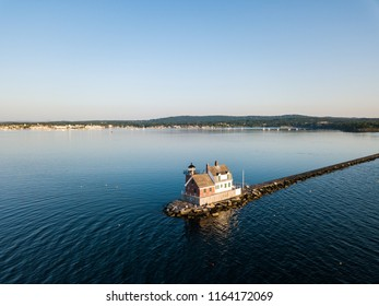 The Rockland Breakwater Lighthouse at the end of the mile long breakwater in Rockland Maine as viewed via an aerial drone image in the mornng light