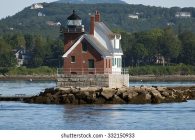 Rockland Breakwater lighthouse lies at the end of a long stone breakwater to guide mariners into Rockland Harbor in Maine.