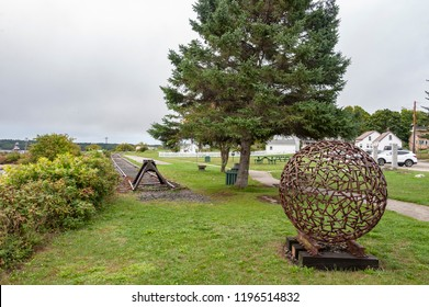 Rockland, Maine, USA - September 19, 2018: Globe created from railroad spikes at Sandy Beach Park, part of a popular harborside trail for local walkers
