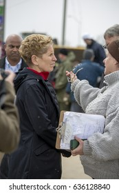 Rockland, ON -  May 8, 2017: Ontario  Premier Kathleen Wynne talking with volunteers and organizers of local flood relief.