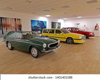ROCKLEIGH, NEW JERSEY - FEBRUARY 1, 2019: Three Volvos on display in a showroom. The three vehicles are Volvo's iconic Cream Yellow 850 T5-R 850 estate, an XC70, and a P1800 ES.
