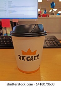 ROCKLEIGH, NEW JERSEY - JUNE 5, 2019: A BK Café Coffee foam coffee cup with plastic lid on a desktop. Burger King's coffee  is made with 100% Arabica beans and every cup is freshly brewed.