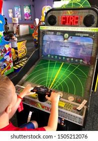 Rocklin, CA - September 7, 2019: Boy playing a Sea Wolf torpedo shooting video game at Chuck E Cheese's.