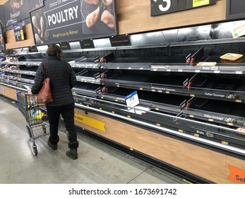 ROCKLIN, CALIFORNIA- March 15, 2020: As the panademic sets in over the Coronavirus, shoppers are buying staples at such a rapid pace stores can't keep the shelves stocked.