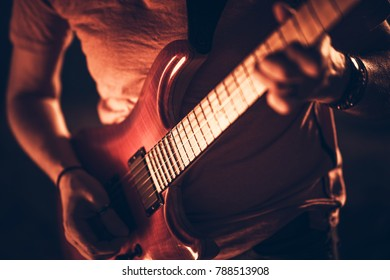 Rockman with the Guitar. Closeup Photo. Modern Electric Guitar String Instrument.
