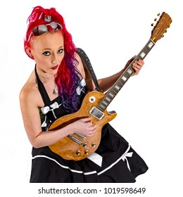 Rock'n'Roll singer with red hair and  guitar