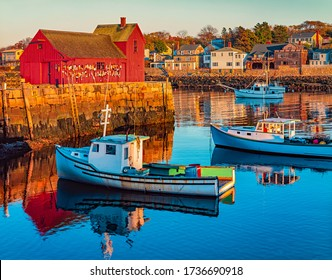 Rockport Harbor in Massachusetts with it's lobster boats  and village reflect in the still water of the day. The colors give the town a nostalgic feeling.