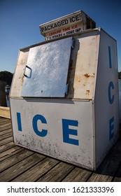 Rockport, Maine / USA - July 12, 2014: A rusty ice machine sits on the dock providing ice and bait for fishermen at Rockport Harbor, Maine.