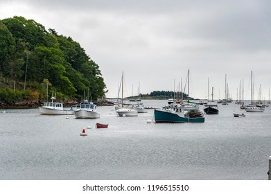 Rockport, Maine, USA - September 19, 2018: Mix of lobster boats and pleasure boats anchored off Rockport Marine Park in Rockport harbor