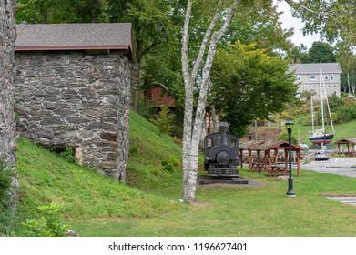 Rockport, Maine, USA - September 19, 2018: Vulcan steam locomotive and lime kilns displayed in Rockport Marine Park, which was a lime processing site in the 1890s