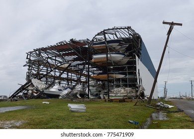 Rockport, Texas / USA - August 26 2017: Hurricane Harvey major wind damage and destruction to Cove Harbor steel frame boat storage building in Aransas County.