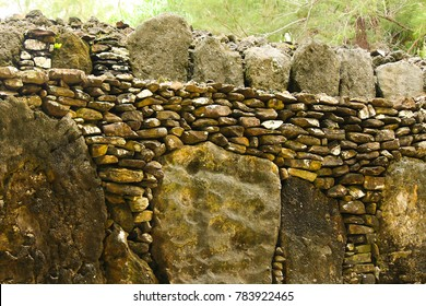 Rocks in archaeological site Marae on Huahine island, French Polynesia