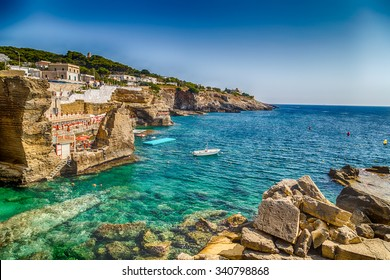 Rocks and architecture of the coast of Salento of the Ionian Sea in Italy,  in Santa Cesarea Terme, Lecce, Apulia